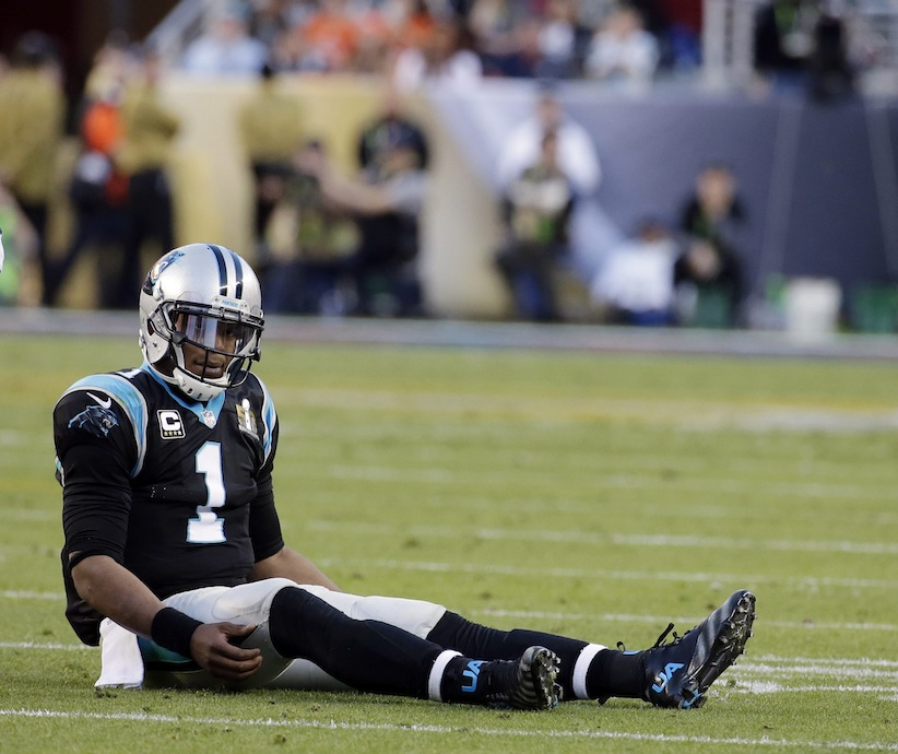 Carolina Panthers' Cam Newton (1) sits on the field during the first half of the NFL Super Bowl 50 football game Sunday, Feb. 7, 2016, in Santa Clara, Calif. (AP Photo/Matt York)