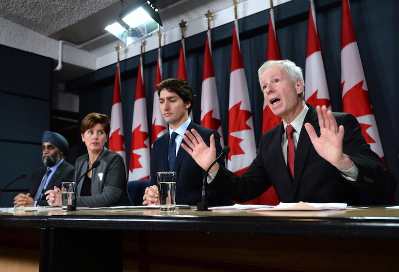 Minister of Foreign Affairs Stephane Dion delivers a statement as he is joined by Prime Minister Justin Trudeau, right to left, Minister of International Development and La Francophonie Marie-Claude Bibeau and Minister of National Defence Harjit Sajjan during a press conference at the National Press Theatre in Ottawa on Monday, Feb. 8, 2016. THE CANADIAN PRESS/Sean Kilpatrick