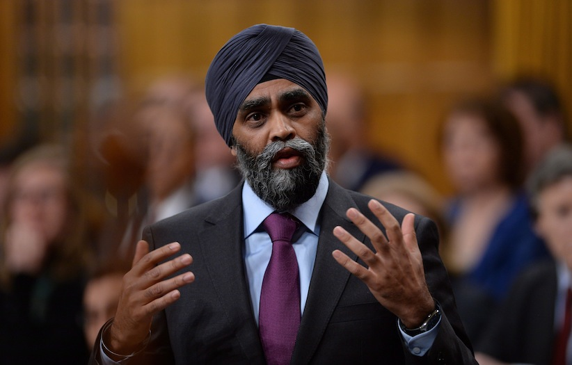 Minister of National Defence Minister Harjit Singh Sajjan responds to a question during question period in the House of Commons on Parliament Hill in Ottawa on Tuesday, Feb. 16, 2016. THE CANADIAN PRESS/Sean Kilpatrick