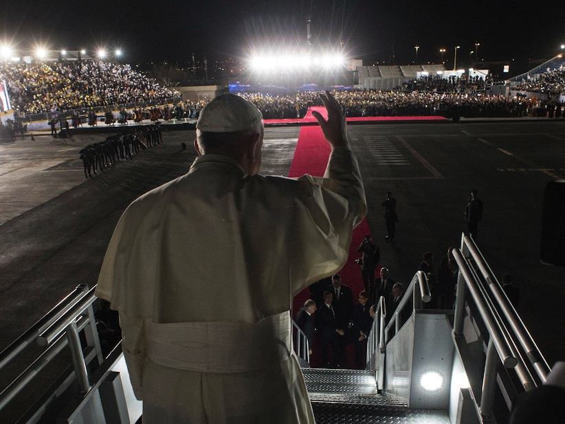 Pope Francis waves as he boards his flight to Rome during the farewell ceremony at Ciudad Juarez, Mexico. (L'Osservatore Romano/Pool Photo via AP)
