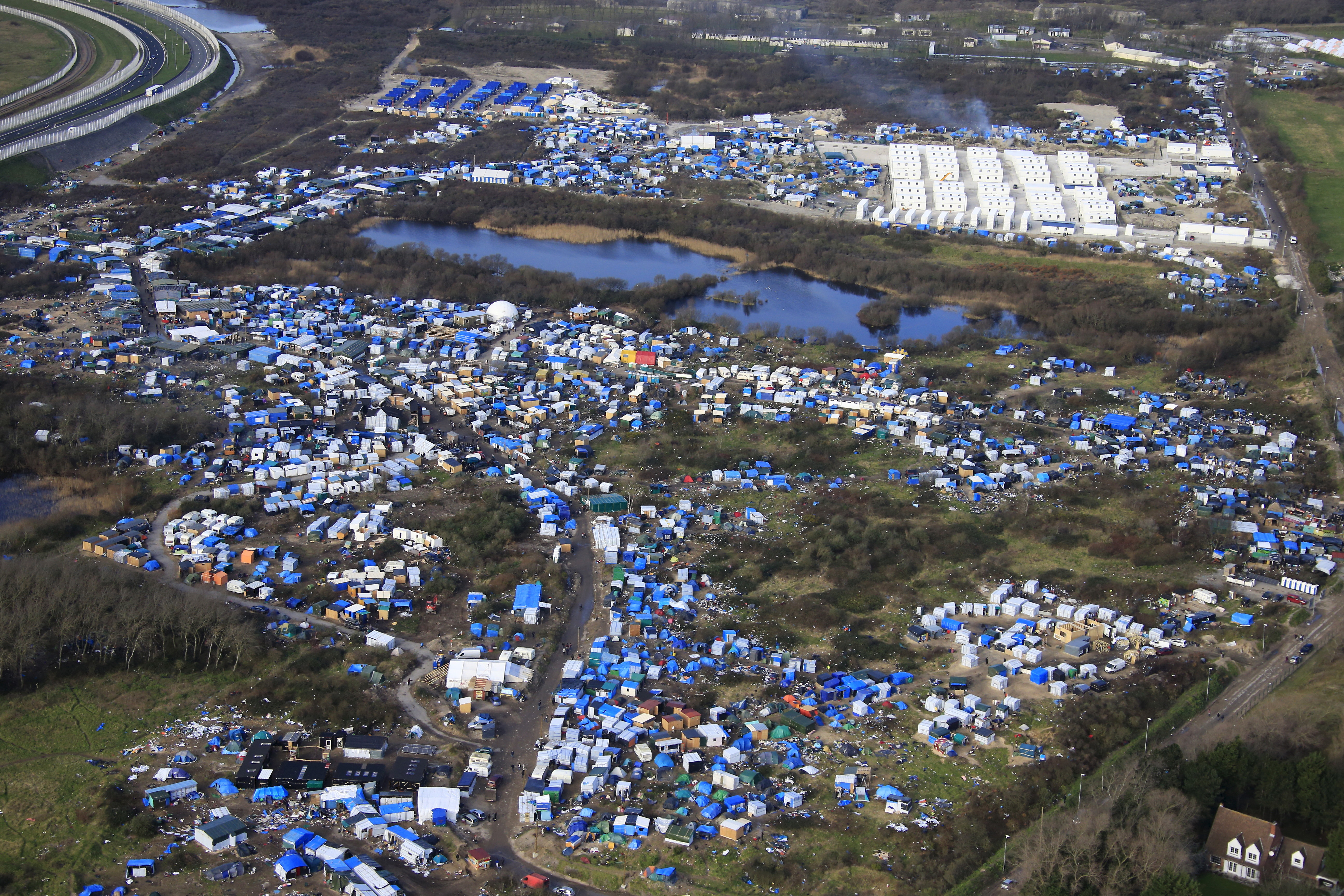 Symbol of migrant crisis calais camp set for destruction aerial view of a makeshift camp as containers rear are put into place to biocorpaavc Images