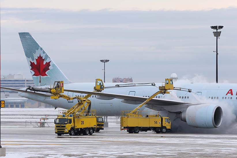 Air Canada planes get de-iced on the tarmac by crews at Pearson International Airport in Toronto. Toronto is back under a cold weather alert, causing yet more flight delays and travel havoc. January 20, 2014. (Rene Johnston/Toronto Star/Getty Images)