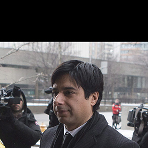 Former CBC radio host Jian Ghomeshi walks past protesters as he arrives at a Toronto court for day six of his trial on Tuesday, Feb. 9, 2016. THE CANADIAN PRESS/Chris Young