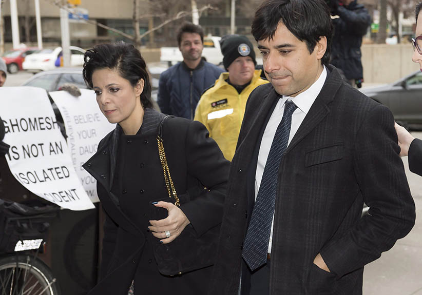 Jian Ghomeshi walks in front of protesters as he arrives at a Toronto courthouse with his lawyer Marie Henein (left) for the third day of his trial. (Frank Gunn/CP)