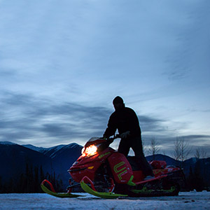 Clint Pelletier, of Edmonton, Alta., is silhouetted while loading his snowmobile onto a trailer after snowmobiling with his wife at Mount Renshaw near McBride, B.C., on Saturday January 30, 2016. Five snowmobilers died Friday in a major avalanche in the Renshaw area east of McBride. (DARRYL DYCK/CP)