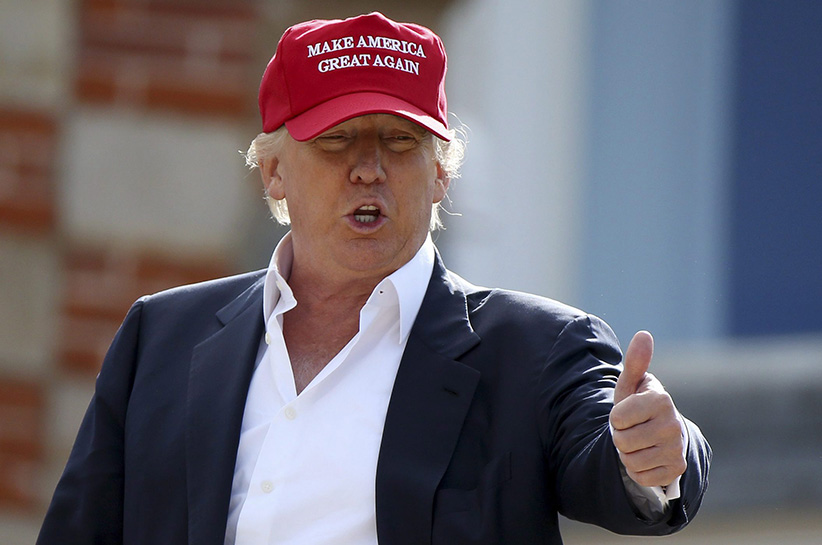 Presidential contender Donald Trump, speaks to the media after arriving by helicopter during the 1st first day of the Women's British Open golf championship on the Turnberry golf course in Turnberry, Scotland, Thursday, July 30, 2015. (Scott Heppell/AP)