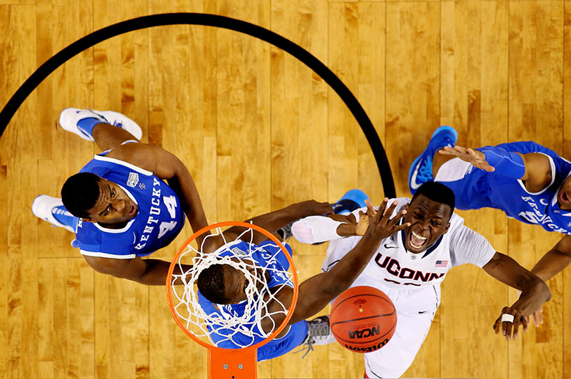 Amida Brimah #35 of the Connecticut Huskies battles with Julius Randle #30 of the Kentucky Wildcats for a rebound during the NCAA Men's Final Four Championship at AT&T Stadium on April 7, 2014 in Arlington, Texas. (Jamie Squire/Getty Images)