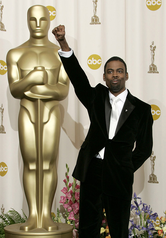 Comedian Chris Rock pumps his fist backstage after hosting the 77th annual Academy Awards in Hollywood, February 27, 2005. (Robert Galbraith/Reuters)