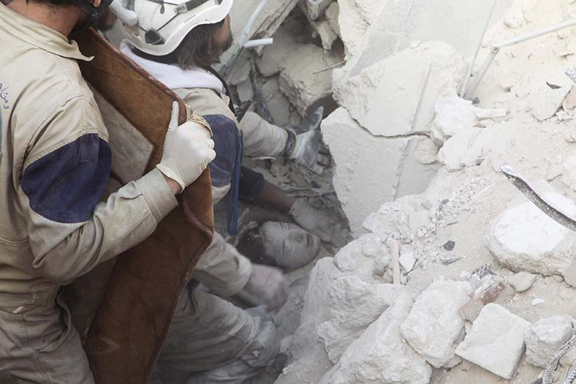 Civil defence members rescue a girl from under the rubble after airstrikes by pro-Syrian government forces in the rebel held al-Qaterji neighbourhood of Aleppo, Syria February 14, 2016. (Abdalrhman Ismail/Reuters)