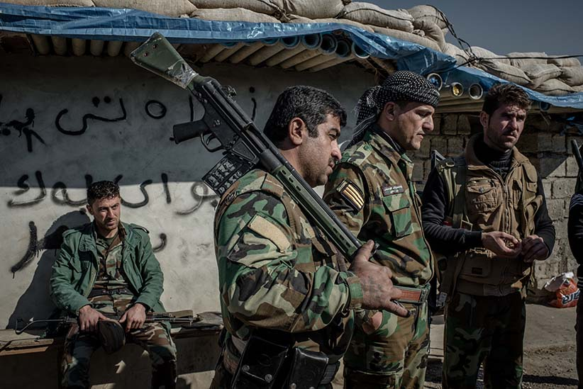 Peshmerga fighters at a frontline southwest of Kirkuk, Iraq. Many Peshmerga fighting ISIS haven't been paid a salary over four months due to the economic crisis in Kurdistan. (Photograph by Cengiz Yar)