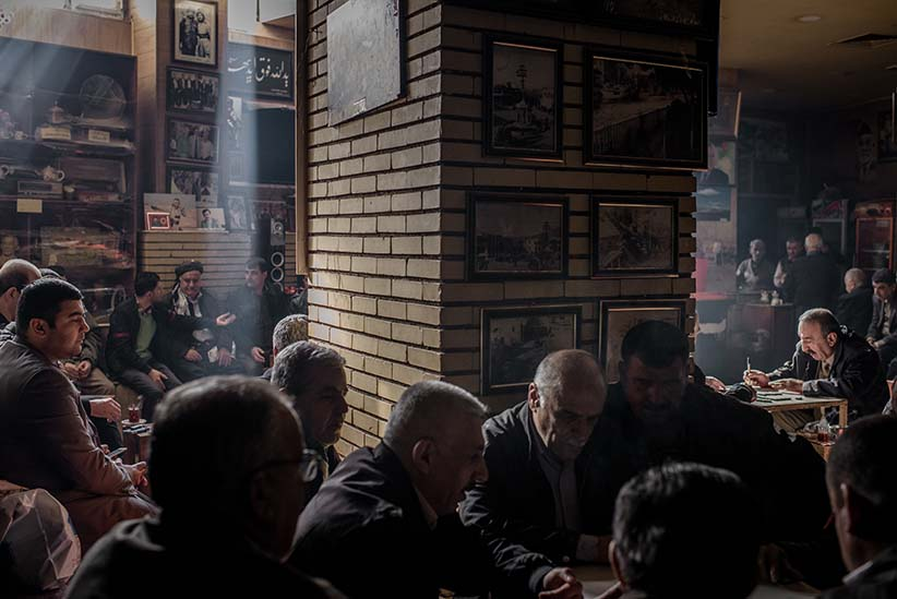 People playing games and hanging out at an old tea shop in the city center of Sulaymaniyah, Kurdistan, Iraq. As the economic crisis deepens in Kurdistan, government salaries aren't being paid and people are struggling to continue their daily life. (Photograph by Cengiz Yar)