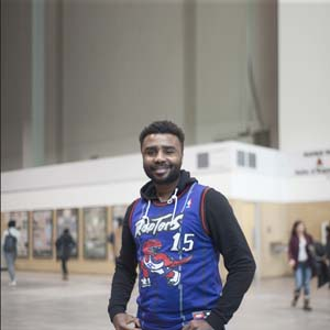 Jerry Anim-Ansah of Toronto wears a Vince Carter Raptors jersey at the Enercare Centre on the second day of the NBA All-Star weekend in Toronto on Saturday, Feb. 13, 2016. Anim-Ansah owns three jersey says he's the biggest raptors fan. He owns jersey to represent the city and team he supports. Photo by Hannah Yoon