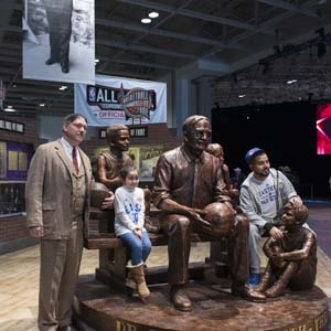 A Dr. James Naismith impersonator poses with a few fans at the Dr. James Naismith statue at the Enercare Centre on the last day of the NBA All-Star weekend in Toronto on Sunday, February 14, 2016. Naismith is a Canadian who founded basketball in 1891 because he needed an activity for students to do indoors because of the cold weather. (Photograph by Hannah Yoon)