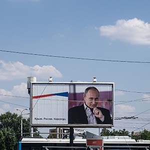 "A billboard of Vladimir Putin reads  ""Crimea. Russia. Forever"" in Simferopol on August 17, 2015 in Simferopol, Crimea. Russian President Vladimir Putin signed a bill in March 2014 to annexe the Crimean peninsula but Ukraine and most of the international community do not recognise its annexation. (Alexander Aksakov/Getty Images)"