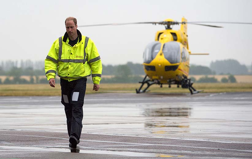 CAMBRIDGE , UNITED KINGDOM - JULY 13: Prince William, The Duke of Cambridge as he begins his new job with the East Anglian Air Ambulance (EAAA) at Cambridge Airport on July 13, 2015 in Cambridge, England. The former RAF search and rescue helicopter pilot will work as a co-pilot transporting patients to hospital from emergencies ranging from road accidents to heart attacks. (Stefan Rousseau/Getty Images)