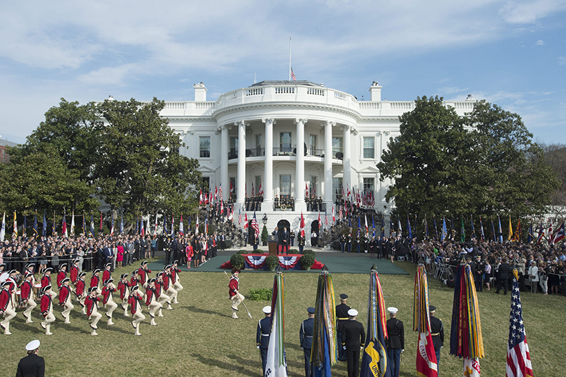US President Barack Obama (C-L) and Prime Minister of Canada Justin Trudeau (C-R) watch the Fife and Drum Corps perform at an arrival ceremony on the South Lawn of the White House, in Washington, DC, USA, 10 March 2016. This is the first official visit of Prime Minister of Canada Justin Trudeau to the White House. (Michael Reynolds/EPA/CP)