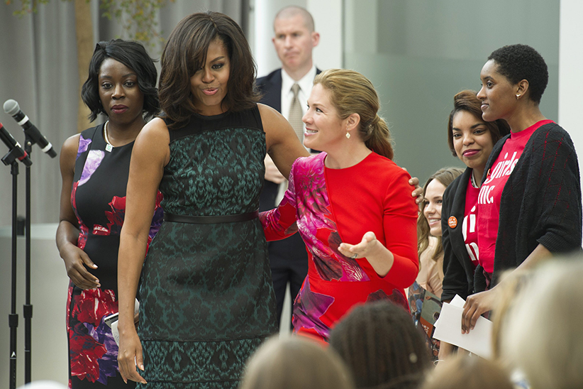 First lady Michelle Obama and Sophie Grégoire-Trudeau, wife of Canadian Prime Minister Justin Trudeau, walk to their chairs after the first lady lost her balance walking off of a stage while they participate in a program at the U.S. Institute of Peace in Washington, Thursday, March 10, 2016, to highlight Let Girls Learn efforts and raise awareness for global girl's education. (Cliff Owen/AP)