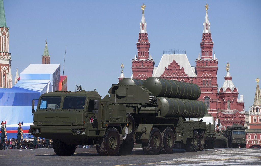 In this Tuesday May 7, 2013 file photo, Russian S-400 air defense missile systems make their way through Red Square during a rehearsal for the Victory Day military parade in Moscow, Russia. In a move raising the potential threat of a Russia-NATO conflict, Russia said Wednesday Nov. 24, 2015 it will deploy long-range air defense missiles to its base in Syria and destroy any target that may threaten its warplanes following the downing of a Russian military jet by Turkey. (AP Photo/Alexander Zemlianichenko, File)