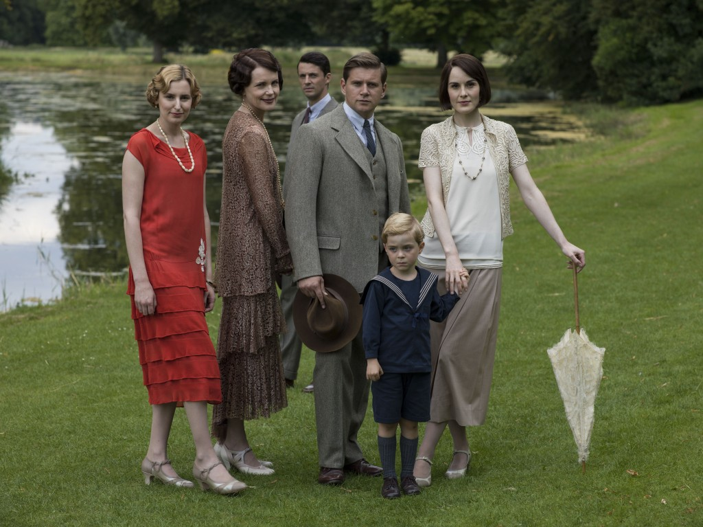 Shown from left to right: Laura Carmichael as Lady Edith, Elizabeth McGovern as Cora, Countess of Grantham, Matthew Goode as Henry Talbot, Allen Leech as Tom Branson, Zac/Oliver Barker as Master George, and Michelle Dockery as Lady Mary (C) Nick Briggs/Carnival Film & Television Limited 2015 for MASTERPIECE