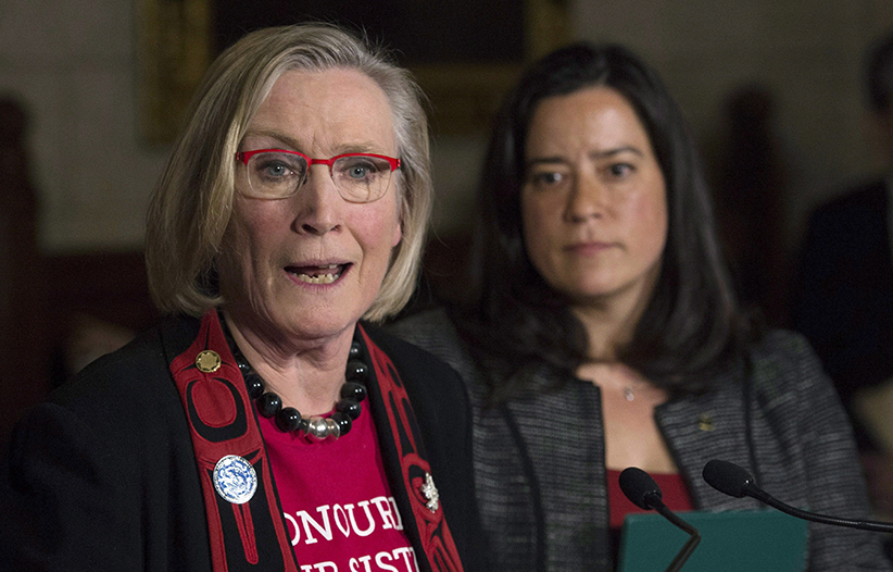 Minister of Justice and Attorney General of Canada Jody Wilson-Raybould looks on as Minister of Indigenous and Northern Affairs Carolyn Bennett responds to a question during an announcement for a Missing and Murdered Indigenous Women inquiry during a news conference in the Foyer of the House of Commons Tuesday December 8, 2015 on Parliament Hill in Ottawa. (Adrian Wyld/The Canadian Press)