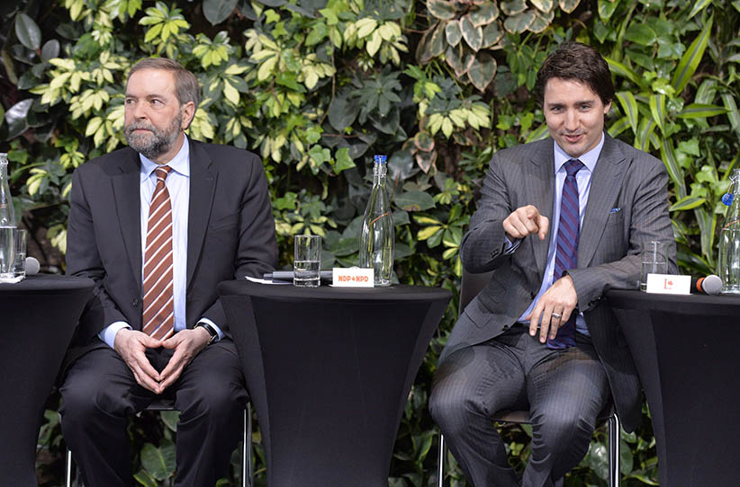"NDP Leader Tom Mulcair and Liberal Leader Justin Trudeau attend a panel discussion at the ""iVote - jeVote"" event in Ottawa, Tuesday March 25, 2014. (Adrian Wyld/CP)"