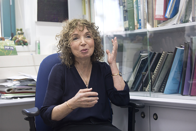 Portrait of Michal Schwartz in her office at the Weizmann Institute, in the city of Rehovot. (Photograph by Kobi Wolf )