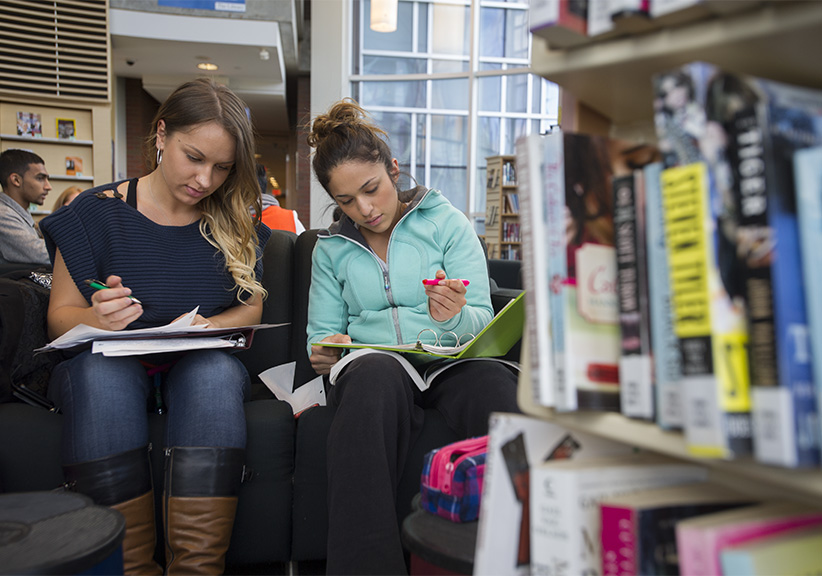 Third year nursing students Valentina Blinova and Irene Moran study in the fireside reading room at the library on campus at UOIT in Oshawa, ON. (Photograph by Cole Garside)