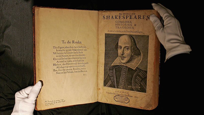 A Sotheby's employee handles a copy of William Shakespeare, The First Folio 1623 on July 7, 2006 in London, England. The most important book in English Literature, the First Folio edition of Shakespeare's plays (1623), will be offered in Sotheby's sale of English Literature & History on July 13th, and is estimated to fetch GBP 2.5-3.5 million. (Scott Barbour/Getty Images)