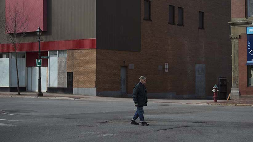 An elderly man walks through Saint John, N.B's empty downtown on Sunday morning, March 6, 2016. (Photograph by Darren Calabrese )