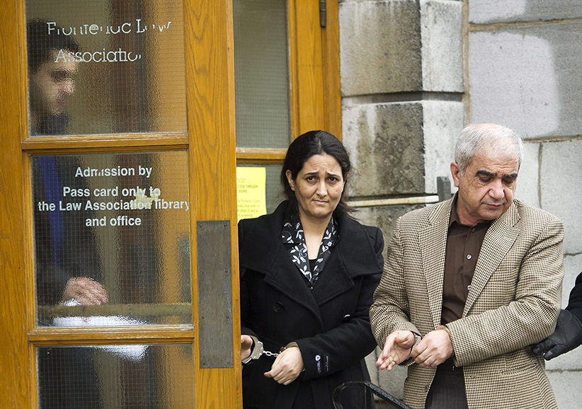 Mohammad Shafia, right, Tooba Yahya, centre, and their son Hamed Shafia, left, are escorted during a lunch break at the Frontenac County courthouse in Kingston, Ontario on Friday, January 27, 2012. (Nathan Denette/CP)
