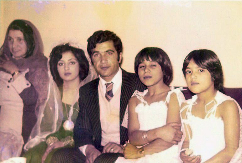 Photo said to show Rona Amir Mohammad (second left) and Mohammad Shafia (centre) at their engagement ceremony in Afghanistan in this circa 1980 handout photo. Photo was sent to the media by email by a purported family member. (CP)