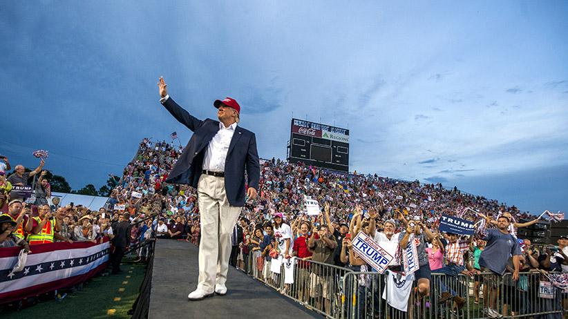 U.S. Republican presidential candidate Donald Trump takes the stage at Ladd-Peebles Stadium in Mobile, Alabama. The Donald Trump campaign moved the rally to a larger stadium to accommodate demand. (PMark Wallheiser/Getty Images)