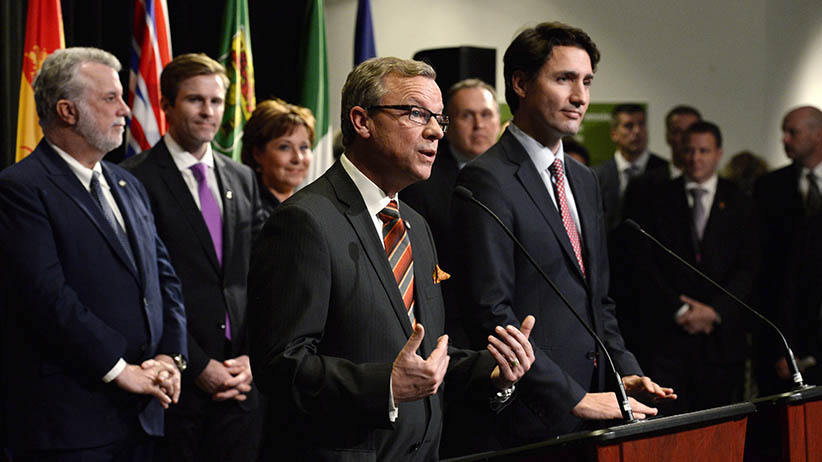 Saskatchewan Premier Brad Wall (centre) speaks following the family photo op during a First Ministers meeting at the Canadian Museum of Nature in Ottawa on Monday, Nov. 23, 2015. (Adrian Wyld/CP)