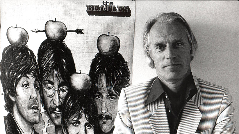 Photo of George Martin with poster of Beatles (Rob Verhorst/Redferns/Getty Images)