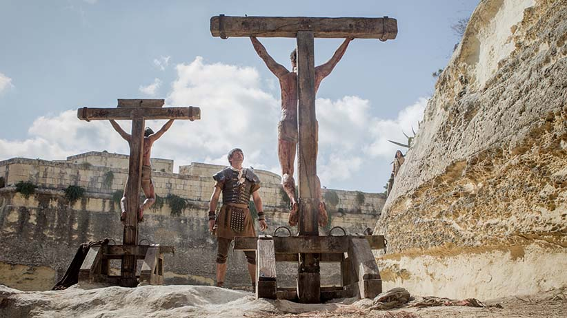 Jesus crucified along with other convicted criminals in Columbia Pictures' RISEN, in theaters nationwide, Feb. 19, 2016. (Columbia Pictures)