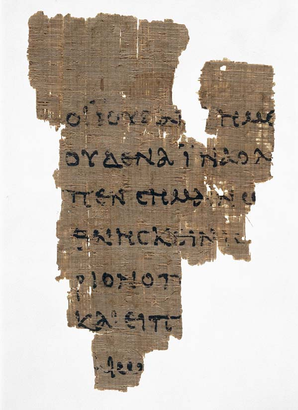 Papyrus fragment of St John's Gospel, Chapter 18, verses 31-33, in which Christ appears before Pilate. It was discovered in Upper Egypt, possibly at Oxyrhynchus. It is part of a codex, and is the earliest known fragment of the New Testament in any language. It was acquired by The John Rylands Library in 1920. (The John Rylands Library)