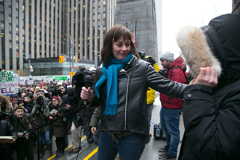 "TORONTO, ON - MARCH 24, 2016 After addressing a few hundred supporters gathered outside Old City Hall, witness Lucy DeCoutere introduces ""Witness No. 1"" whose identity is under a publication ban. Ryerson University's Centre for Women and Trans People stages a rally at Old City Hall in response to Ghomeshi verdict and to show support for the #WeBelieveSurvivors and #IBelieveSurvivors movement. Chris So/Toronto Star/Getty Images"