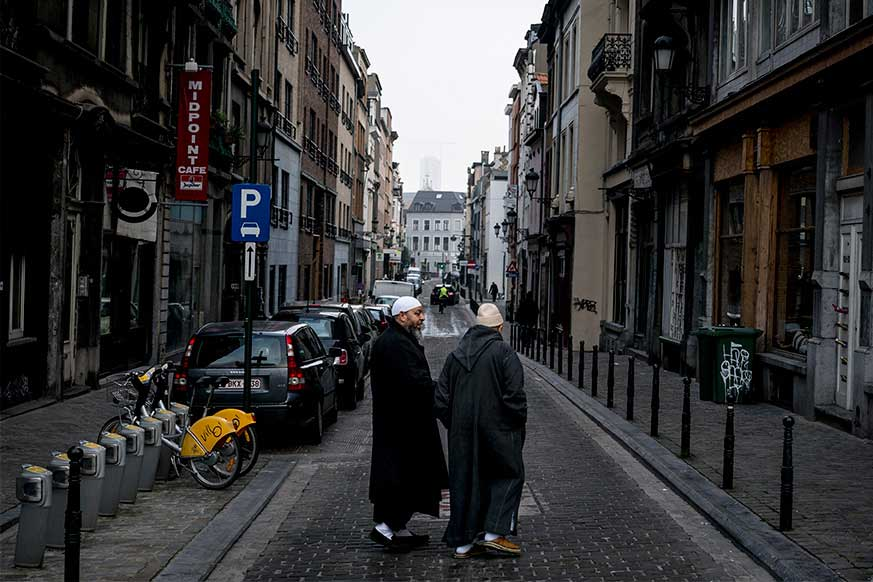 Two men in the Molenbeek district, a neglected inner-city area of Brussels in economic decline, Jan. 25, 2015. (Andrew Testa/The New York Times)
