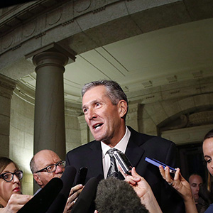 Manitoba Conservative and opposition leader Brian Pallister speaks to media after Manitoba Finance Minister Greg Dewar read the 2015 budget for the province at the Manitoba Legislature in Winnipeg, Thursday, April 30, 2015. THE CANADIAN PRESS/John Woods