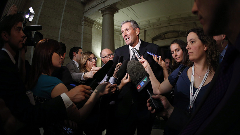 Manitoba Conservative and opposition leader Brian Pallister speaks to media after Manitoba Finance Minister Greg Dewar read the 2015 budget for the province at the Manitoba Legislature in Winnipeg, Thursday, April 30, 2015. (John Woods/CP)