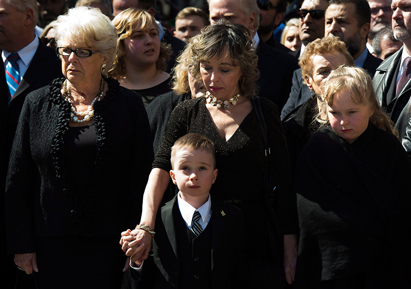 Mother Diane Ford, left to right, son Doug Ford Jr., wife Renata Ford and daughter Stephanie Ford wait outside city hall ahead of the funeral procession to St. James Cathedral for former mayor Rob Ford in Toronto on Wednesday, March 30, 2016. (Frank Gunn/CP)