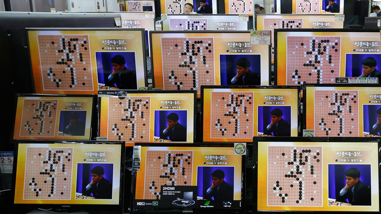 South Korean professional Go player Lee Sedol is seen on TV screens during the Google DeepMind Challenge Match against Google's artificial intelligence program, AlphaGo, at the Yongsan Electronic store in Seoul, South Korea, Wednesday, March 9, 2016. Google's computer program AlphaGo defeated its human opponent, Lee, in the first game of their highly anticipated five-game match. (Ahn Young-joon/AP)