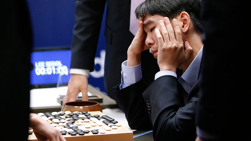 South Korean professional Go player Lee Sedol reviews the match after finishing the final match of the Google DeepMind Challenge Match against Google's artificial intelligence program, AlphaGo, in Seoul, South Korea, Tuesday, March 15, 2016. Google's Go-playing computer program again defeated its human opponent in a final match on Tuesday that sealed its 4:1 victory. (Lee Jin-man/AP)