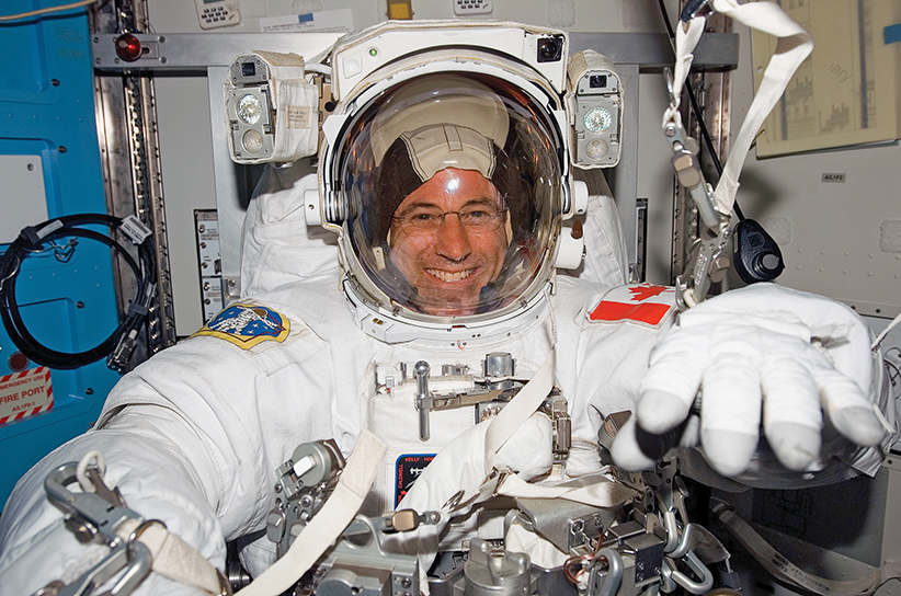 View of STS-118 Canadian Space Agency Astronaut and Mission Specialist (MS), Dafydd Williams, attired in his Extravehicular Mobility Unit (EMU) in the Quest/Airlock (A/L) after a session of Extravehicular Activity (EVA). (NASA)