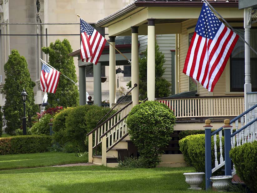 Flags outside American homes. (Istock)