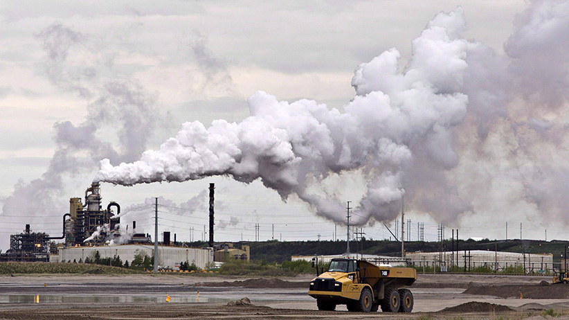 A dump truck works near the Syncrude oil sands extraction facility near the city of Fort McMurray, Alberta on Sunday June 1, 2014. The furore over a New Democrat candidate's remarks about leaving a lot of Alberta's oilsands in the ground is a reflection of how poorly the issue is understood, say energy experts. (Jason Franson/CP)