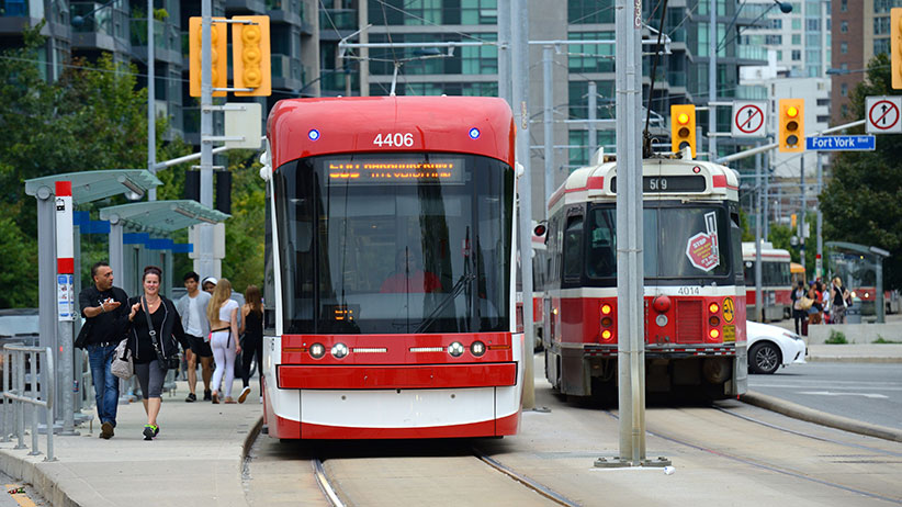 The TTC's new Bombardier Flexity low-floor light rail vehicle is pictured beside an older light rail vehicle, also known locally as a streetcar, in Toronto on August 29, 2015. (Stephen C. Host/CP)