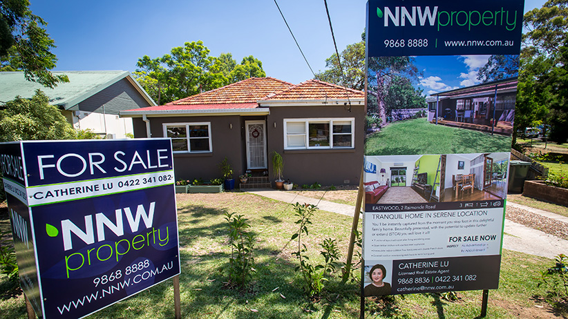 "A ""For Sale"" sign stands on display outside a house in the suburb of Eastwood in Sydney, Australia, on Saturday, Jan. 11, 2014. Purchases by locally resident Chinese and those from mainland China are inflating housing bubbles in and around Sydney, where prices in some suburbs have surged as much as 27 percent in the past year. (Ian Waldie/Bloomberg/Getty Images)"