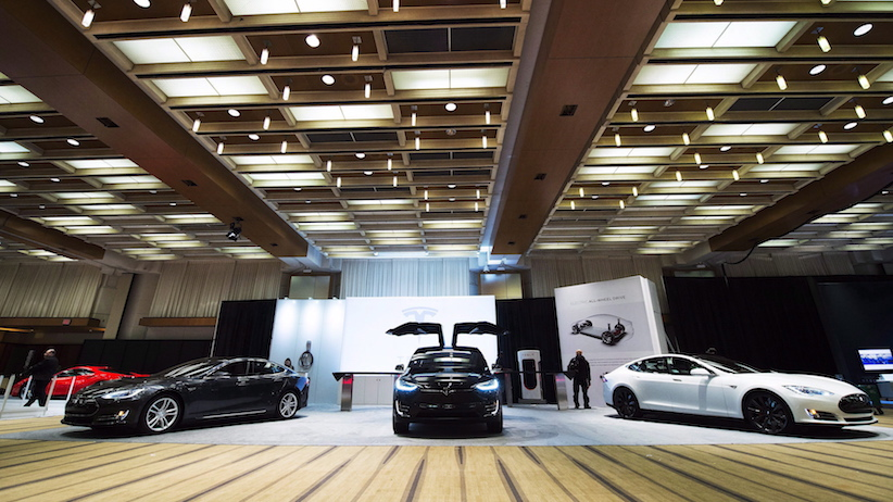 Tesla vehicles are shown at the 2016 Canadian International Autoshow in Toronto on Thursday, February 11, 2016. THE CANADIAN PRESS/Nathan Denette