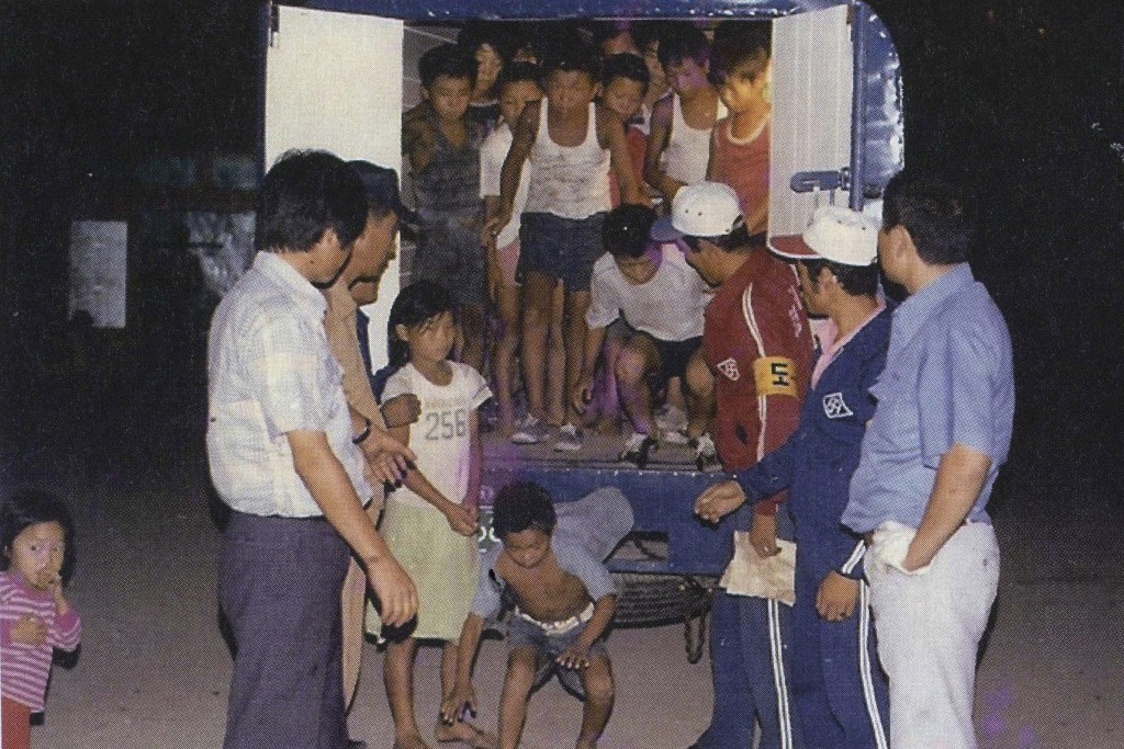 In this undated image provided by the Committee Against Institutionalizing Disabled Persons, a civic group representing the former inmates at the Brothers Home, guards unload children from a truck in Busan, South Korea. An Associated Press investigation shows that rapes and killings of children and the disabled three decades ago at a South Korean institution for so-called vagrants, the Brothers Home, were much more vicious and widespread than previously realized. It also reveals that the secrecy around Brothers has persisted for decades because of a cover-up orchestrated at the highest levels of government.(Committee Against Institutionalizing Disabled Persons via AP) MANDATORY CREDIT, NO SALES, NO ARCHIVE